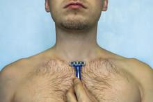 Man Shaving His Chest With Raz...