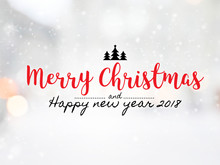 """Massage """" Merry Christmas And Happy New Year 2018"""" On Blurred Bokeh With Snowfall Background."""