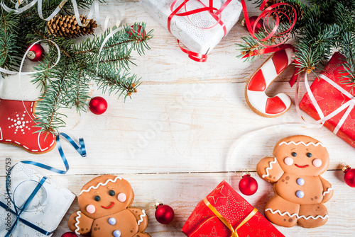 Spoed Foto op Canvas Chocolade Festive Christmas wooden white background, with Christmas tree branches, pine cones, decorations, Christmas gifts and gingerbread, top view copy space