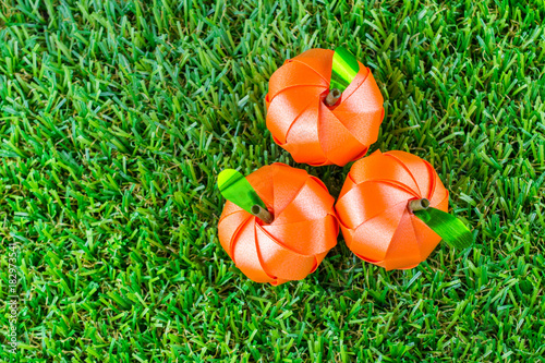 Cuadros en Lienzo Coin folding with Ribbon is shaped orange fruit for ordination scatter ceremony of buddhism