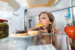 Happy Woman Eating Donut From Plate