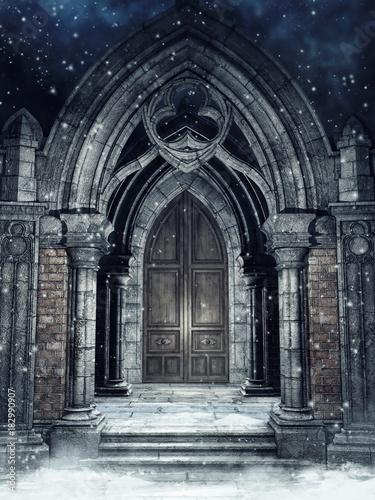 Slika na platnu Zimowa sceneria z gotycką bramą nocą