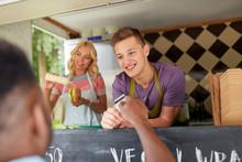 Salesman Taking Customer Credit Card At Food Truck