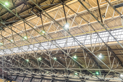 Metal trusses covering an industrial long-span building with an antiaircraft lan Wallpaper Mural