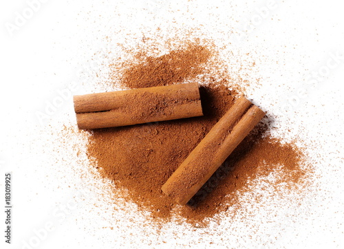 Fototapeta cinnamon sticks with powder isolated on white background obraz