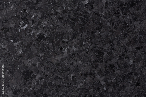 Black natural granite texture for design.