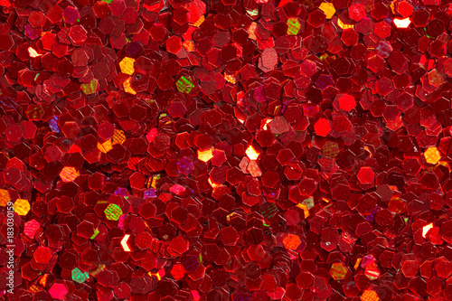 Carmine red figurines on glitter background. - 183030159