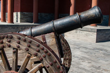 Rusty Cannon On Wooden Wheeled...