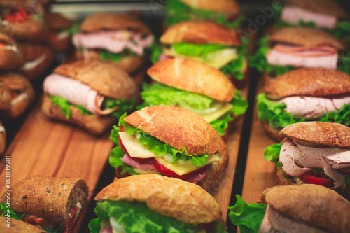 Beautifully decorated catering banquet table with different food snacks and appetizers with sandwich, on corporate christmas birthday kids party event or wedding celebration