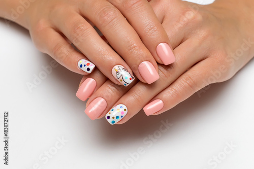 Aluminium Prints Manicure gentle pink manicure with painted unicorn on fingers and confetti on square nails on white background