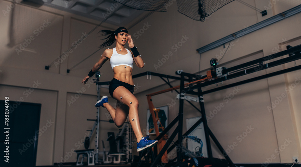 Fototapety, obrazy: Movement and performance monitoring of runner in biomechanical l