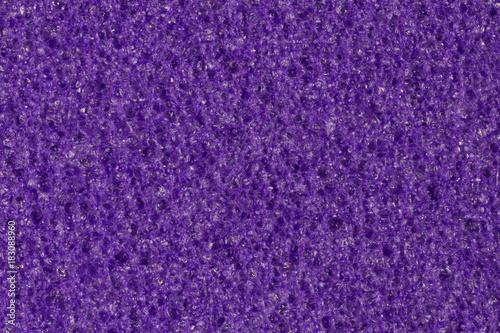 Photo Dark violet foam (EVA) texture with contrast porous surface.