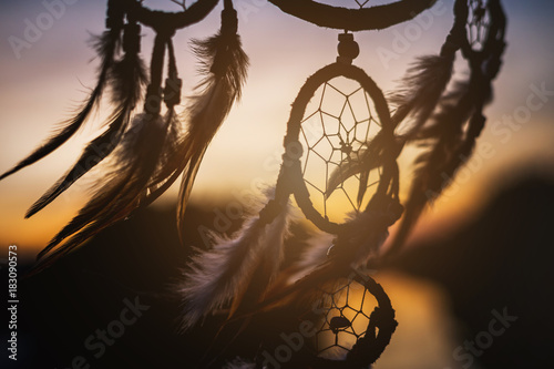 Foto  Dream catcher in the wind with beautiful sunset