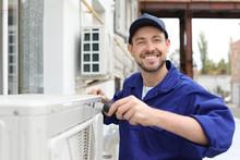 Male Technician Repairing Air ...