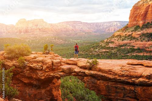Arizona Travel in Devil's Bridge Trail, man Hiker with backpack enjoying view, Sedona, Arizona, USA