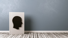 Book With Human Head Shape On Wooden Floor, Biography Concept