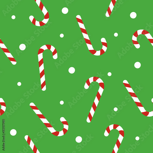 fototapeta na ścianę Christmas seamless pattern with candy canes, snow ball on green background. Background for wrapping paper, fabric print, greeting cards. Winter Holiday design