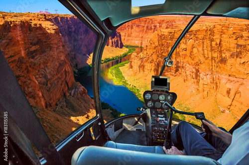 Poster Helicopter Helicopter cockpit with pilot arm and control console inside the cabin on the Grand Canyon Lake Powell. Reserve on the Colorado River, straddling the border between Utah and Arizona. USA, America.