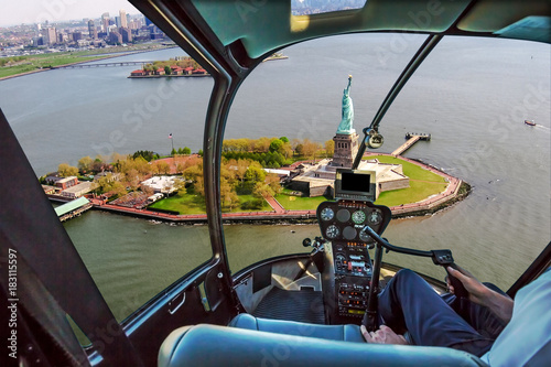 Poster Helicopter Helicopter flight view of Liberty Island and the famous Statue of Liberty monument symbol of New York City, United States.