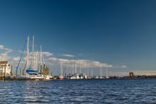 Sailboats Berthed Along The Waterfront