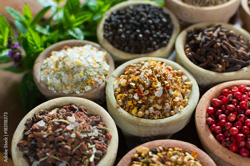 Photo  Variety of different asian and middle east spices, colorful assortment, on old w
