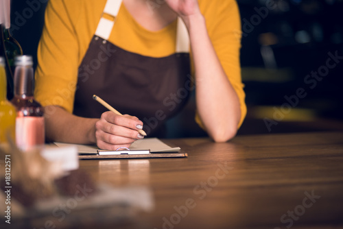 Superb Close Up Female Hand Writing Information On Paper By Pencil Interior Design Ideas Ghosoteloinfo