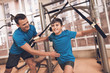 Dad and son in the same clothes in gym. Father and son lead a healthy lifestyle.