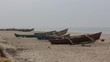 Fishermen in boat on shore in Goa.