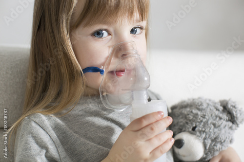 Fotografie, Obraz Little girl making inhalation with nebulizer at home