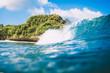 Blue breaking wave in Bali, Indonesia