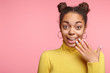 canvas print picture - Excited young black female looks in bewilderment at camera, being pleasant surprised by information about her victory of competition, can`t belive in this, pose against pink background with copy space