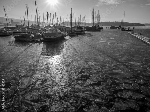 Photo  Sailboats on frozen water