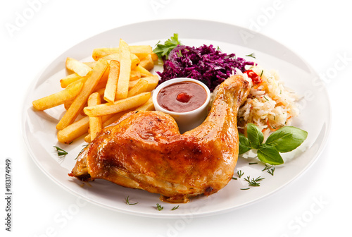Roast chicken legs with chips and vegetables