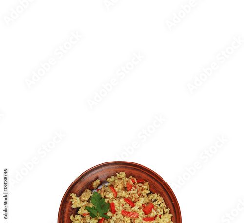 Pilaf on a seafood platter is isolated on white. A traditional dish of Indian and Oriental cuisine.