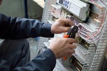 Hands Of Electrician Assemblin...
