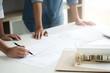 engineers working on blueprint, interior architect concept