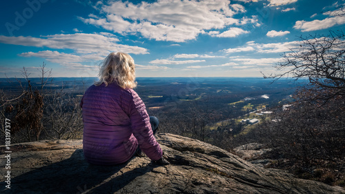 Fototapeta Woman viewing landscape along the Appalachian Trail in Stokes State Forest, New