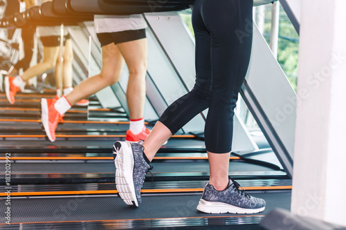 Foto op Plexiglas Fitness People running on machine treadmill at fitness gym.fitness and lifestyle concept