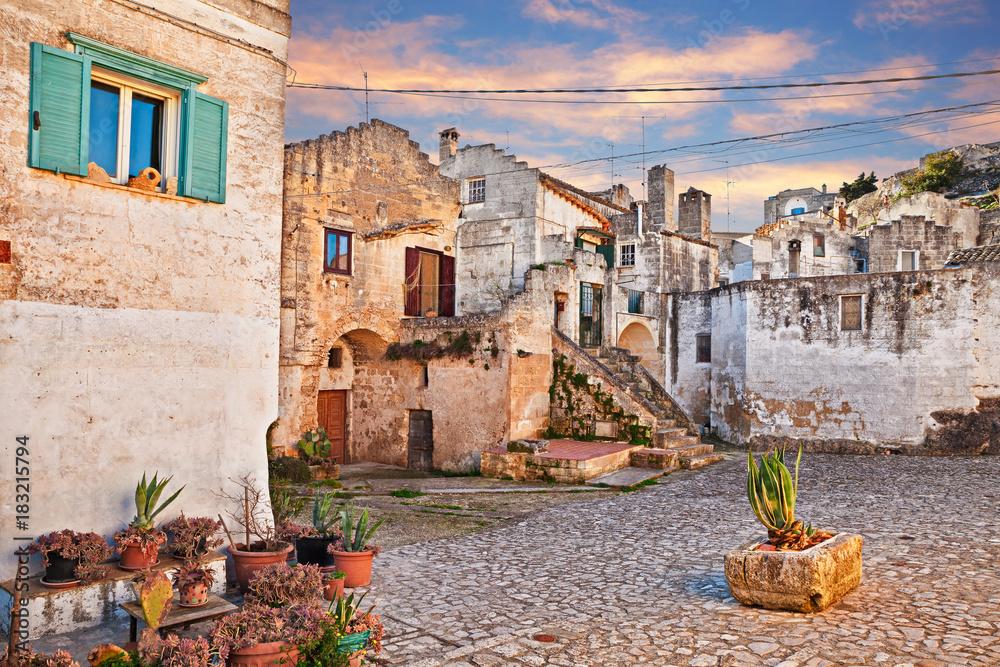 Fototapety, obrazy: Matera, Basilicata, Italy: view at dawn of a small square in the old town Sassi di Matera