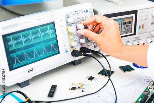 Fotografie, Obraz  Oscilloscope is used by and electronic engineer in laboratory