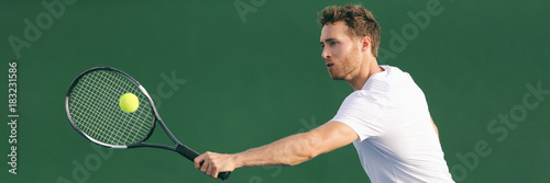 Tennis player hitting ball with backhand racket on hard court Wallpaper Mural