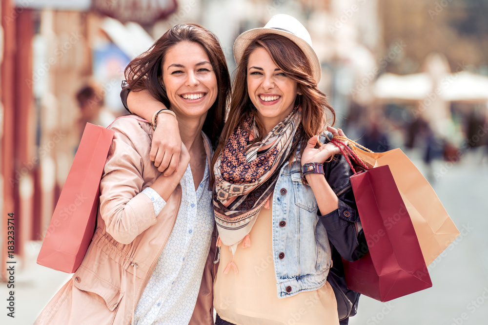 Fototapety, obrazy: Young trendy women shopping in the city.