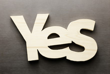 Wood Word Yes On A Grey Background