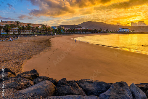Sunrise view of beach Playa Del Caminson, Playa de la Americas on Tenerife, Canary Islands in Spain