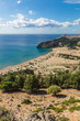 Stony landscape and a view of the Tsambika beach on the Rhodes Island, Greece