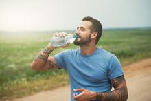 Bearded Man Drinking Bottle Of...