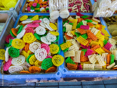 Colorful keropok for sale at a street market in Kuala Lumpur, Malaysia Poster
