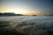 sunrise over the hills with sea fog