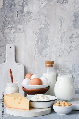 Staande foto Zuivelproducten Dairy products on marble table over concrete background. Cheese, farmers cheese, milk, yogurt, sour cream, eggs and smoked cheese. Organic farmers dairy products