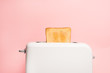 Healthy fashion food of breakfast. Toast in a toaster on a pink background.